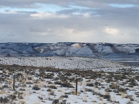 Green River, WY: View of the high country above and behind the hotel where bands of wild horses roam.
