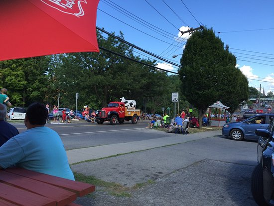 Phelps, NY: View of the Sauerkraut Festival parade from the hot dog stand.