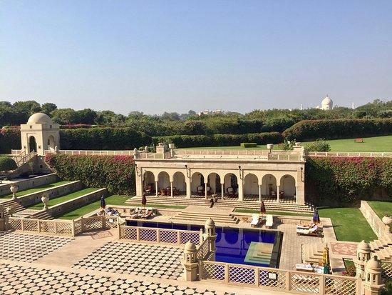 The Oberoi Amarvilas: Oberoi pool area facing Taj Mahal in distance