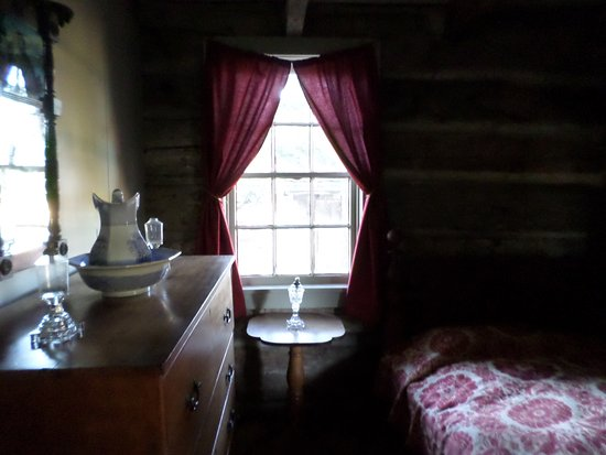 Waterloo, NY: Main floor bedroom in the log home