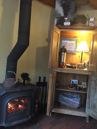 Ranchos De Taos, Nuevo Mexico: Fireplace, coffee, Honey, Tea all in cosy & cute display