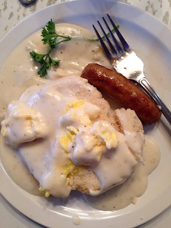 Longview, WA: Scrambled eggs on a biscuit with country gravy and a juicy link sausage.