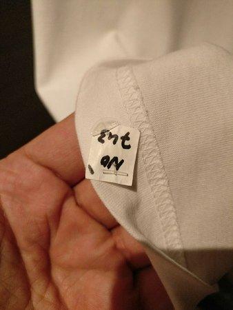 Novotel Dubai Deira City Centre: Not worse way to put laundry label...unbelievable!
