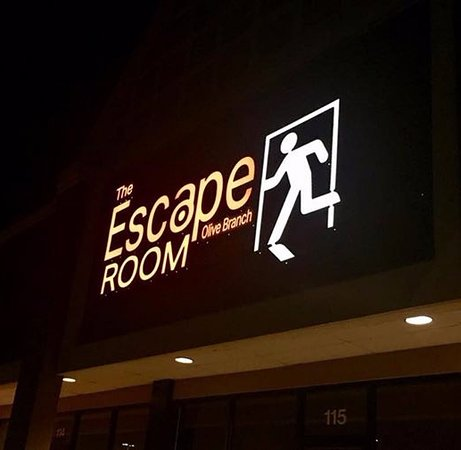 The sign outside The Escape Room Olive Branch.