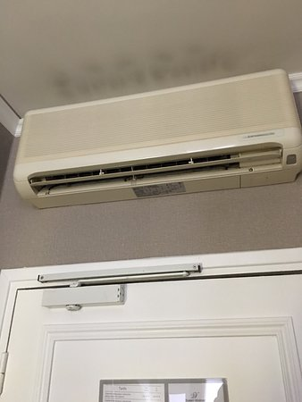 Loud Air Conditioner Filthy Bathroom Small And Uncomfortable