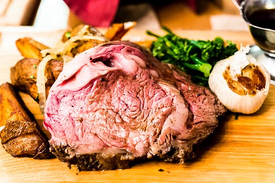Lebanon, OH: Golden Lamb Hickory-Roasted Prime Rib with potatoes, roasted garlic and broccoli rabe