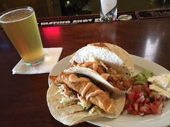 Pueblo, CO: Fish tacos on soft flour tortilla, slaw and sauce.