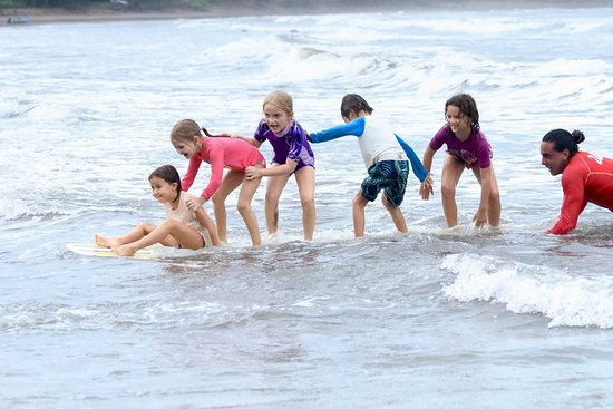 Dominical, Costa Rica: Kids surf lessons for all ages, they love learning to surf!