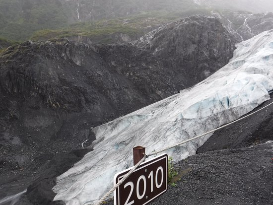 Kenai Fjords National Park, AK: Signs with dates indicate where the glacier used to be. Exit Glacier, Alaska