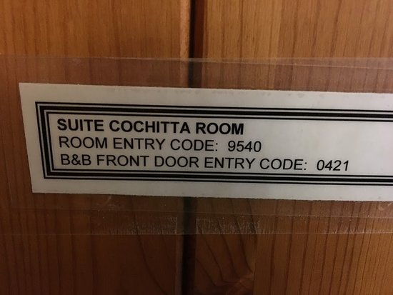 Cali Cochitta Bed & Breakfast: Bedroom and outside doors use combination code locks (this label located on the INSIDE of the do
