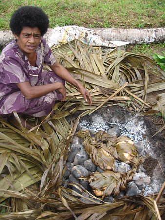 Viti Levu, Fiji: Chicken wrapped in leaves to be baked in the lovo