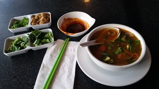 Noodles and Rice Cafe: Tom Yum soup (left) & Spicy Korean Stuffed Fishball soup.