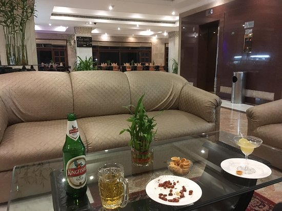 Having a beer in the lobby as this is the only place you can have a drink and get free wifi in t