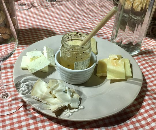 Tuscan Wine Tours by Grape Tours: A variety of cheeses with some truffle honey.