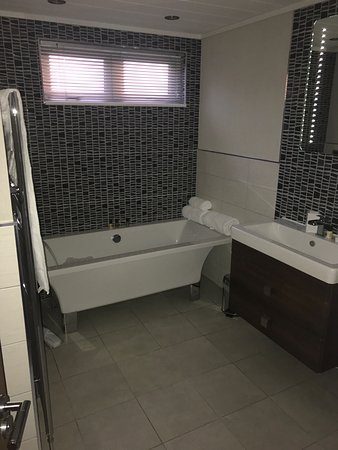 """The 2 bathrooms were very modern """"could even watch the tv in the bath"""" Hot tub is a lovely touch"""