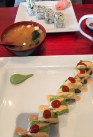 Iowa City, IA: upper plate shows loaded miso soup and california roll and underneath is salmon, avocado and sau