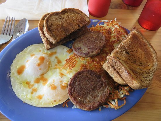 Monroe, TN: Over easy eggs with sausage patties, marbled rye toast and crispy hashbrowns (w/Tabasco)