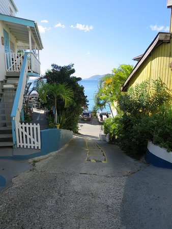The Lighthouse Villas: Steep road with stairs down to the bay