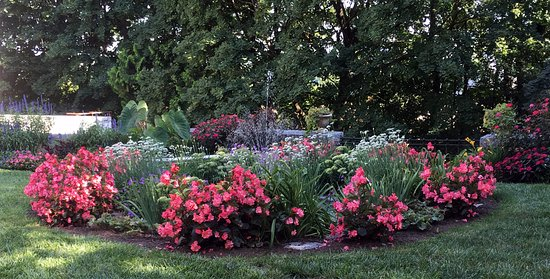Glens Falls, NY: Flower circle with fountain in the reproduction garden.