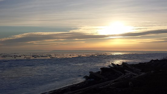 Surrey, Canada: Sunset view with the ice on the shores.