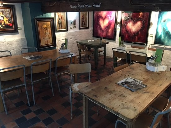Daventry, UK: Our Cellar space seats 16 and also has Frank our funky wood burner to keep you cosy!