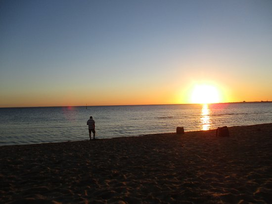 A photo of me taking sunset photos on St Kilda beach