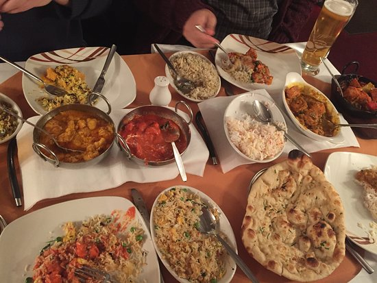 St. Neots, UK : Massala in red, Vandaloo on the right side. All come with rice.