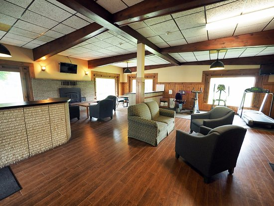 Cadillac, MI: Our fireside lounge area and fitness area
