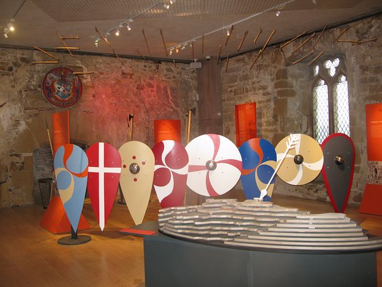 Battle, UK: Modern exhibition in Westgate Tower. Useable pieces of armour for children to try on with adult.