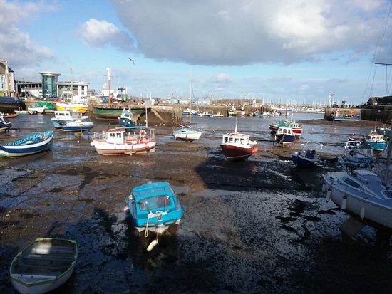 Brixham, UK: stranded boats at low tide
