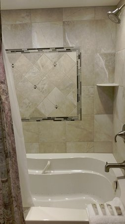 Highridge Condominiums: jacuzzi tub in master bathroom,unit A14