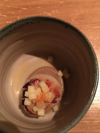 Oldstead, UK: ... and underneath was the warm scallop, lovely and sweet