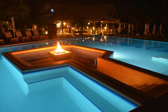 The Fire Pit In The Smaller Pool Is Lit At Night Picture Of Sandals Grenada Resort Spa Pink Gin Beach Tripadvisor