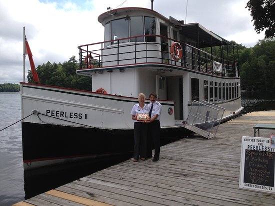 Peerless II at Port Carling dock with Captain & Crew.