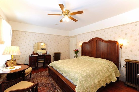 Wainwright Inn: West Wing suite; king bed room, north side, bathroom with shower, ceiling fan, TV, free WiFi