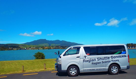 Raglan, New Zealand: 9 seater shuttle vehicle with Mt Karioi as back drop