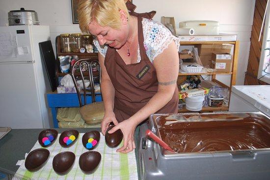 Nakusp, Canada: Jennifer making chocolate Easter eggs.