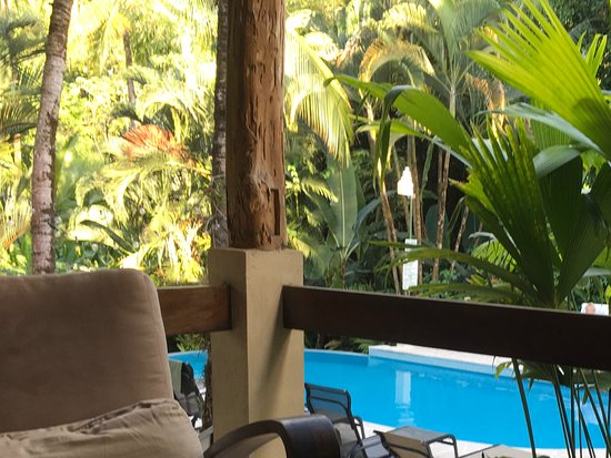 Falls Resort at Manuel Antonio: Looking over the pool from the bar.