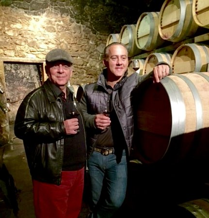 ‪‪Saint-Laurent-des-Combes‬, فرنسا: Posing with my son Anton at the Cellars holding barrels of precious wines !‬