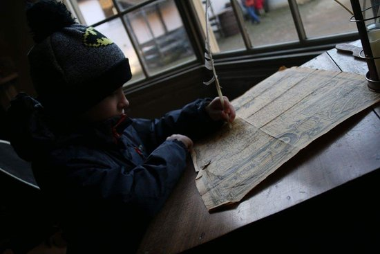 Buckingham, UK: My boy writing with a feather inside the old house