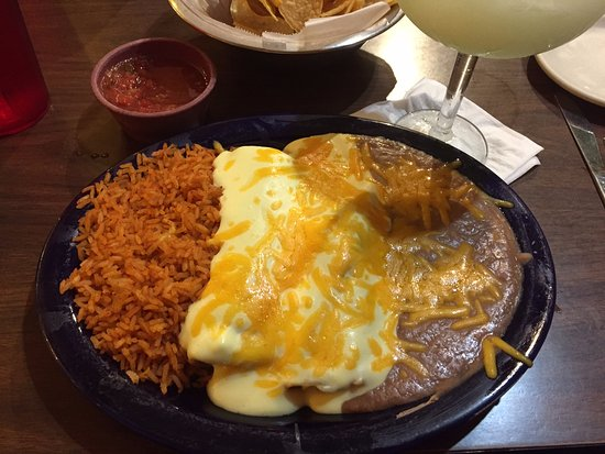 Edmond, OK: Enchilada dinner: one chicken & one spinach with sour cream sauce. Ask for refried beans!