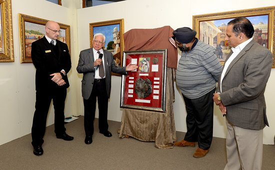 Dandenong, Australia: Dr Parekh (owner of the collection) describing a newly unveiled multi-faith shield