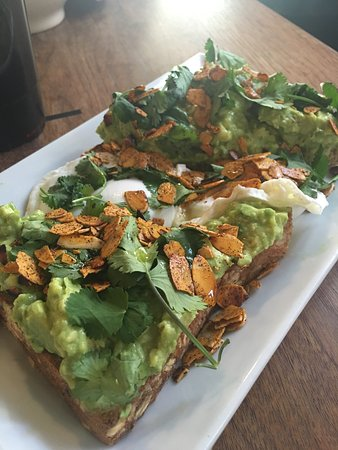 11th Street Cafe: avocado toast with a Poached Egg and toasted almond slivers