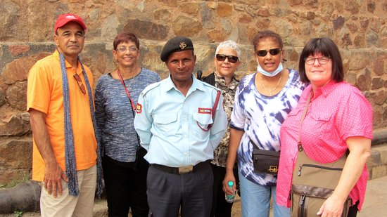 Part of my group with a Security Guard at the Ruins of Qutub Minar.