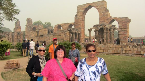 Ruins of the Qutub Minar in the background.