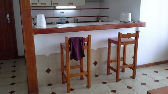 Los Pueblos Apartments: the cooking area and eating area.