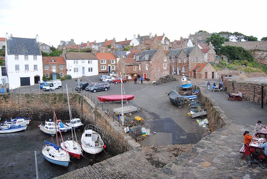 Panorama on Crail Harbour with kiosk and free tables