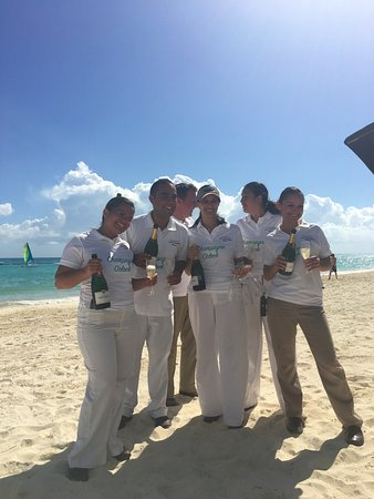 "Rosewood Mayakoba: This is teh adorable beach staff announcing it is ""Champagne O'Clock"" on the beach!"