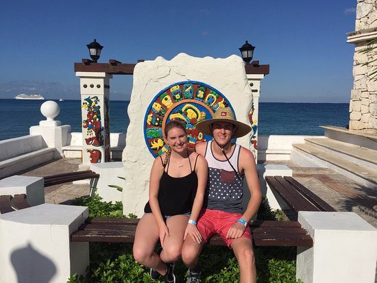 Safe Tours Cozumel: The kids in front of a Mayan calendar I believe!