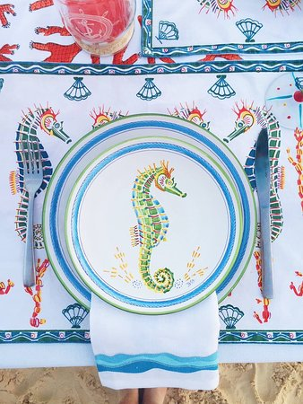 Hamilton, Bermuda: Hand painted seahorse plates with matching table linens.
